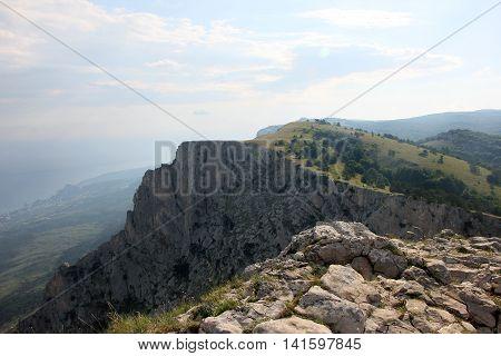 beautiful panoramic view from top of crimean mountain peak Ai-Petri on picturesque plateau Crimea