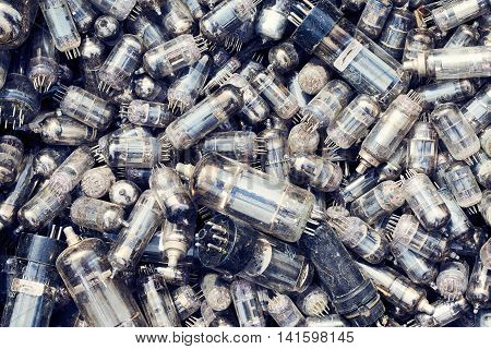 Top view heap of old glass vacuum radio tubes valves