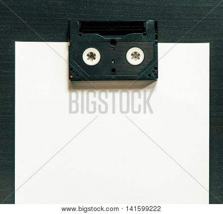Retro Cassette Video Tape on paper for copy space