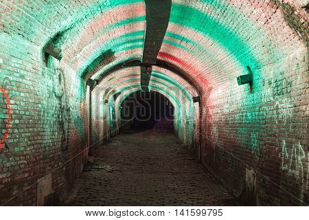 UTRECHT THE NETHERLANDS - JUNE 30: Green and pink illuminated Ganzemarkt tunnel on June 30 2016 in the centre of Utrecht The Netherlands