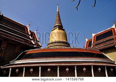 Bangkok Thailand - December 24 2011: Circular cloister twin Ubosot sanctuary halls and great golden bell-shaped Chedi at Royal Wat Ratchabophit