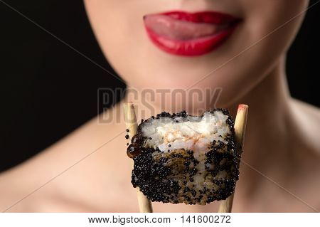 girl licking lips with roll close up