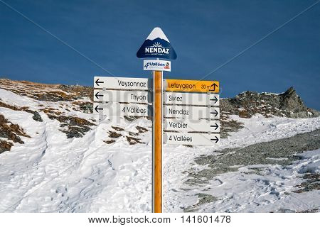 Direction sign at ski resort in the Swiss Alps 4 valleys