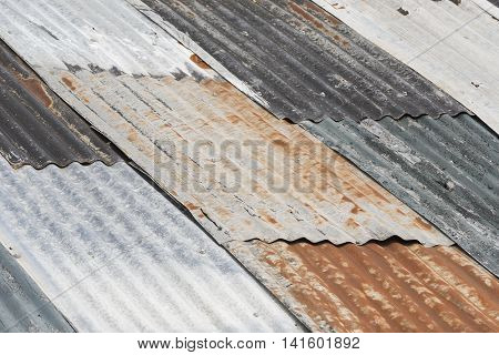 Old weathered corrugated metal as colorful roofing
