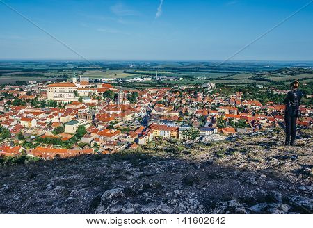 Mikulov Czech Republic - May 18 2015. Woman looks on Mikulov city from the Holy Hill. Mikulov Castle on the left side