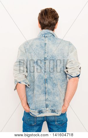 Back View Of Man Holding Hands In Pockets Of Jeans