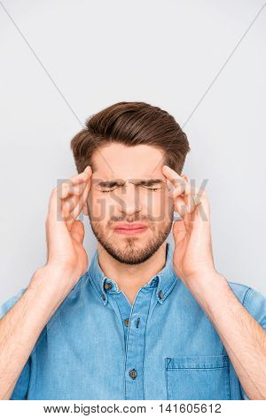 Handsome Young Tired Man With Migraine Touching Head