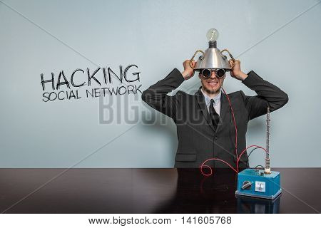 Hacking Social Network text with vintage businessman and machine at office