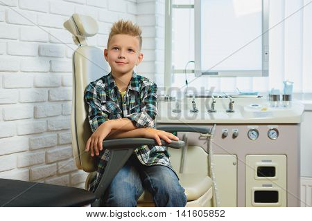 Smiling boy in Otolaryngologist cabinet at clinic.