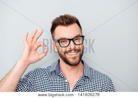 Cheerful Young Man In Spectacles Showing