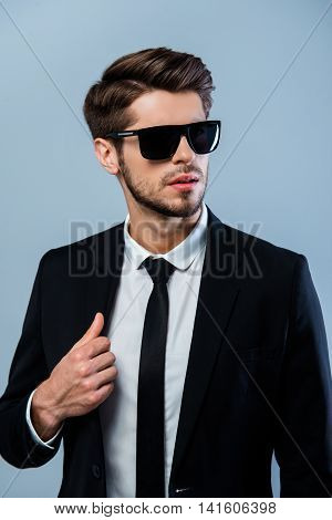 Portrait Of Young Brutal Sexy Man In Black Spectacles