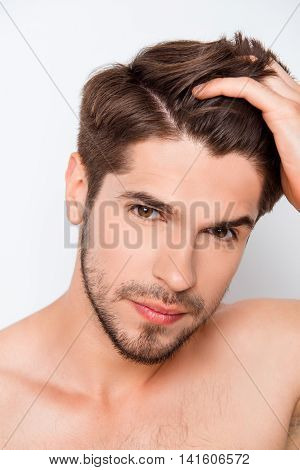 Portrait Of Handsome Bearded Man Combining His Hair