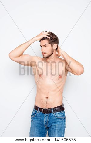 Strong Athletic Muscular Man In Jeans Combining Hair With Fingers