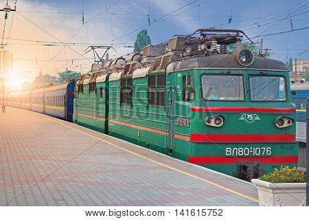ODESSA UKRAINE - JULY 29 2016: An old style passenger train an the railway station of Odessa in the rays of morning sun Ukraine
