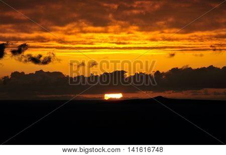 Sunset Between Dark Cloudscape