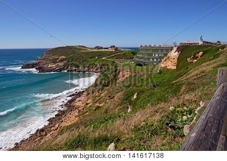 High steep ocean coast in summer day. Spain suburb of Suances summer day in the Province of Cantabria it is photographed from Playa de Los Locos