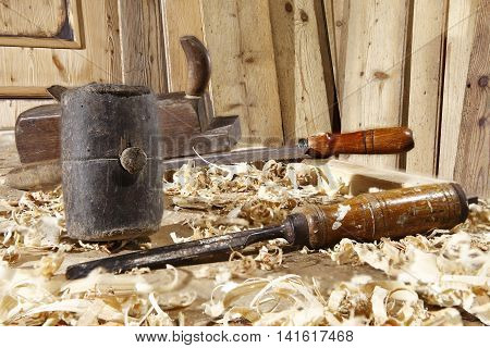 carpenter's tools on the table with wood background