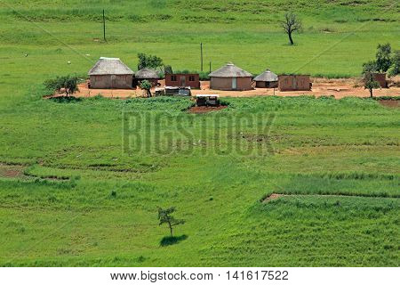 Small rural huts in mountainous grassland, KwaZulu-Natal, South Africa