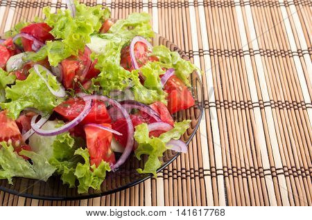 Plate With Vegetarian Salad With Fresh Tomatoes, Onion And Lettuce