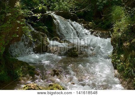 Close-up of an overfalls and rapids of a fast mountain river on the Zlatibor Mountain in Serbia