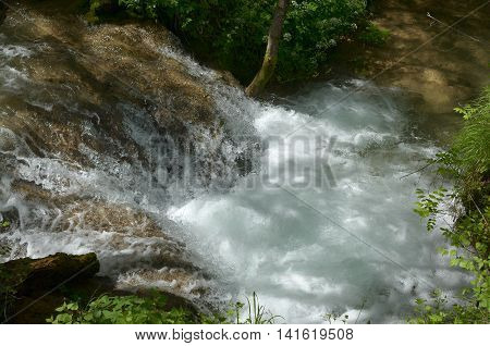 Close-up of cascades of a foamy river water on the Zlatibor mountain in Serbia