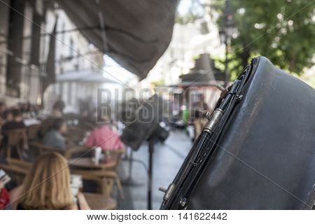 Fan sprinklers splashing vaporized water at terrace bar in order to cool the hot summer temperature in Spain
