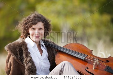 beautiful girl with her cello, outdoors