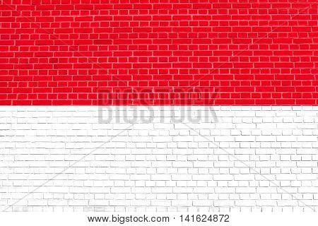 Flag of Indonesia Monaco Hesse on brick wall texture background. Indonesian national flag.