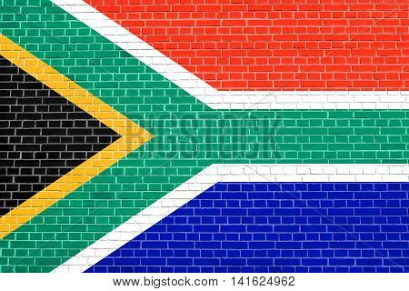 Flag of South Africa on brick wall texture background. South African national flag.