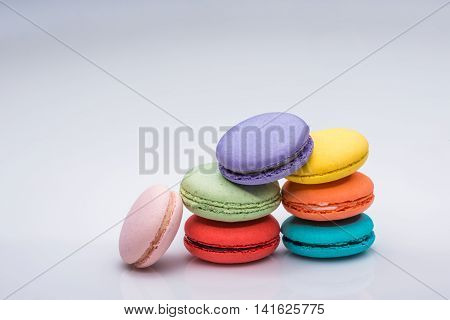 A stack of colorful macaroons on neutral background