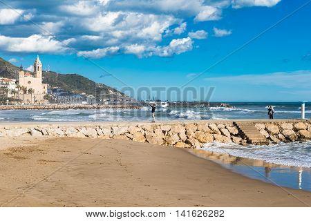 People At Beach In Sitges, Spain