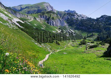 Idyllic mountain scene hiking in the mountains in a sunny day Austrian Alps Rofan Karwendel.