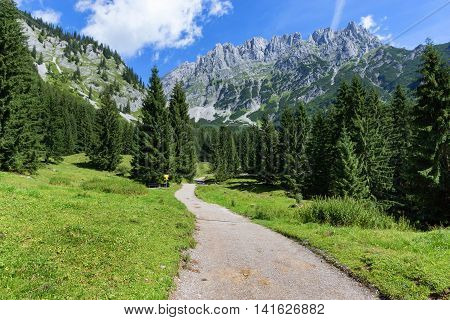 Hiking path through summer mountain landscape. Wild Kaiser cain or Wilder Kaiser Austria Tyrol.