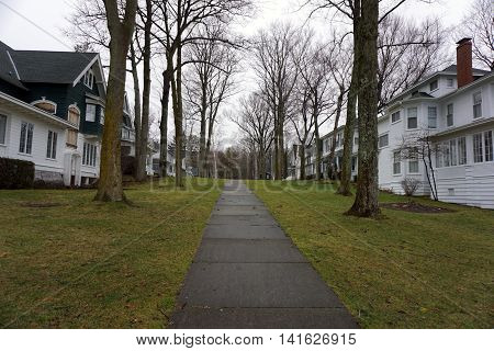 A sidewalk leads to homes from the beach in Wequetonsing, Michigan.