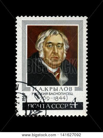 USSR - CIRCA 1969: cancelled stamp printed in USSR shows famous fable writer Ivan Krylov (1769-1844), circa 1969. vintage post stamp isolated on black background.