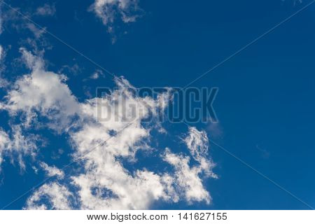 Blue Sky And Dramatic White Clouds Background On Sunny Day