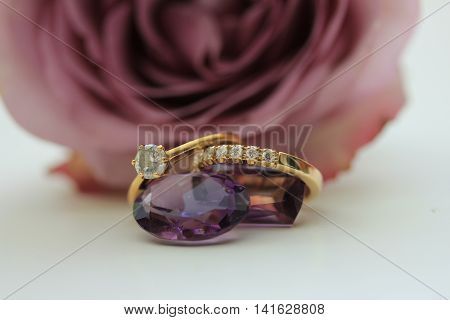 Engagement rings and a piece of Amethyst