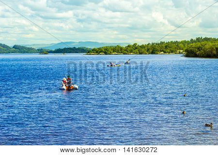 Water sports on calm blue Loch Lomond lake in Scotland, 21 July 2016