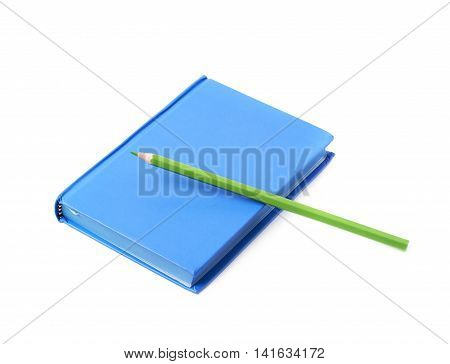 Blue copyspace note book with the drawing pencil over it, composition isolated over the white background
