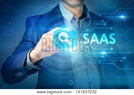 Business, Internet, Technology Concept.businessman Chooses Saas Button On A Touch Screen Interface.