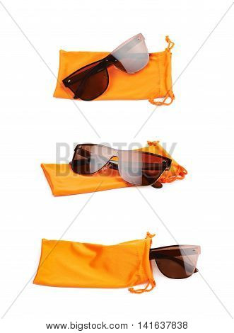 Pair of glasses and protective orange pouch bag with the drawstrings, composition isolated over the white background, set of three different foreshortenings