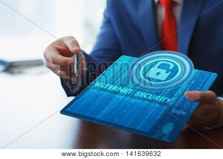 Business, Technology, Internet And Networking Concept. Young Businessman Working On His Tablet In Th