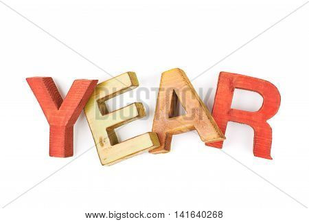 Word Year made of colored with paint wooden letters, composition isolated over the white background