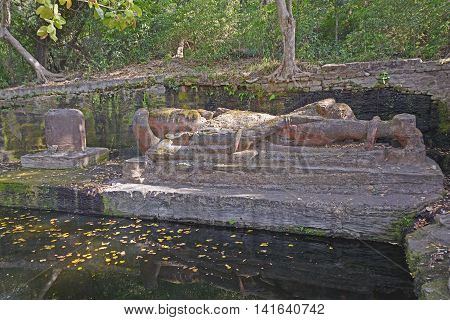 Reclining Vishnu Statue in the Wilderness in Bandhavgarh National park in India