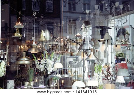 electric- light store. chandelier interior window close up