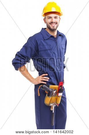 Worker with tool belt standing smiling on white background