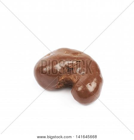 Chocolate coated cashew nut isolated over the white background