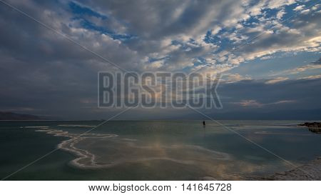 Photographer... Photographed at Dead sea, the lowest place on the Earth minus 423 m,  minus 1,388 ft.  Selfie photo.
