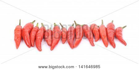 Lined up pile of red italian peppers isolated over the white background
