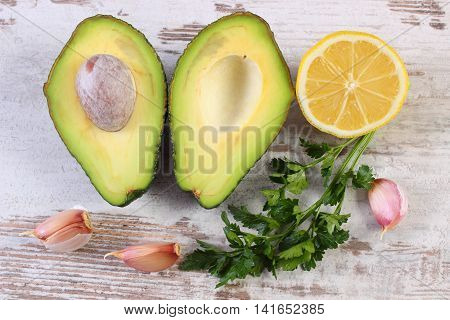 Avocado, Garlic, Lemon And Parsley On Wooden Background, Ingredient Of Avocado Paste Or Guacamole, H